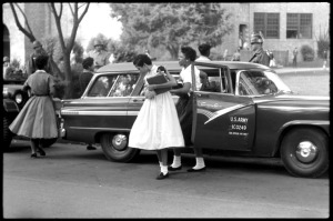 African American students arriving at high school  in U.S. Army car